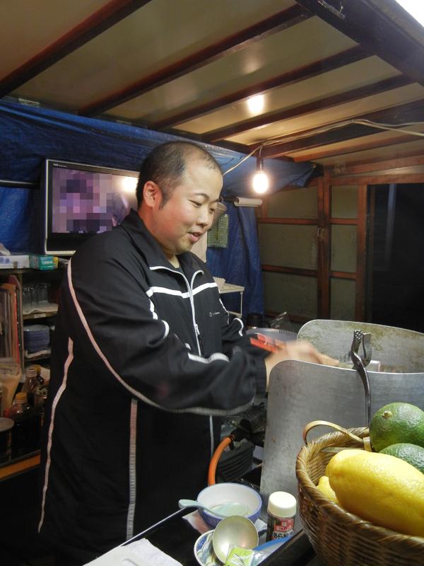 料理中の撫順の大将